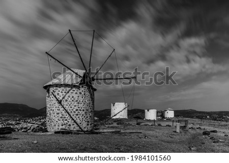 Traditional windmill in Bodrum, Turkey. Long exposure picture, october 2020. Black and white picture