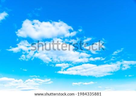 Blue sky in spring. Background with white clouds. The concept of protection from pollution of a clean atmosphere. Picture for weather forecast.