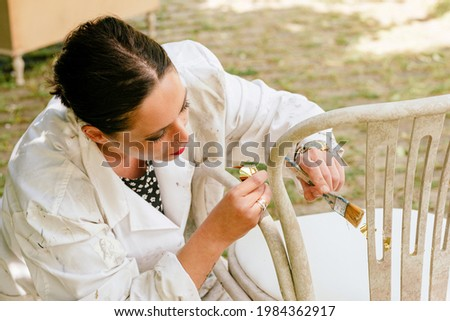 Woman working in her small business of carpentry and restoration of antique furniture.