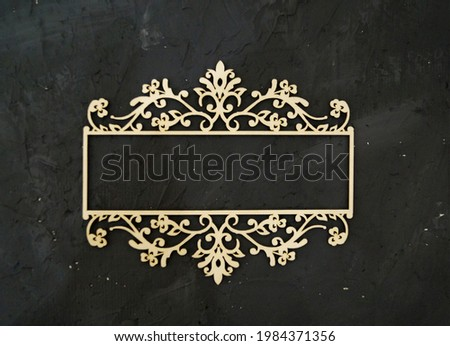 rectangular white frame with monograms mudboard cut-out cardboard on a gray background