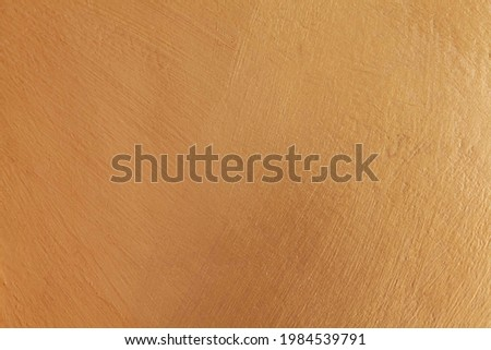 Smooth cement wall inside the building painted in bright gold texture and background seamless Royalty-Free Stock Photo #1984539791