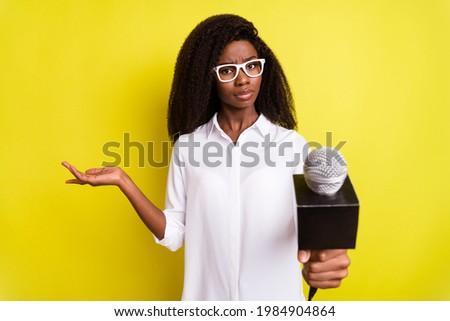 Photo of sweet puzzled dark skin woman dressed white outfit spectacles tacking you interview isolated yellow color background