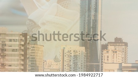 Composition of watermark over modern city buildings. global finance and business technology concept digitally generated image.