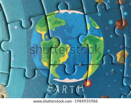 picture of the earth composed of puzzle pieces