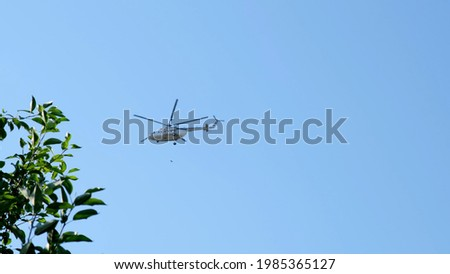 helicopter flies a little in the clouds flying