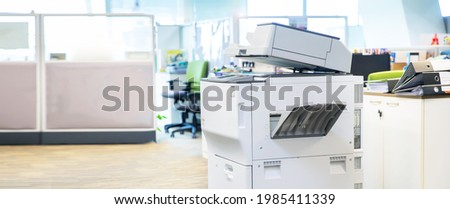Copier printer, Close up the photocopier or photocopy machine for scanning document printing sheet or copy paper and xerox. Royalty-Free Stock Photo #1985411339