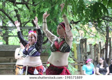 MUSKOGEE, OK - MAY 24: A woman dressed as gypsy performs the Oklahoma 19th annual Renaissance Festival on May 24, 2014 at the Castle of Muskogee in Muskogee, OK.  #198571889