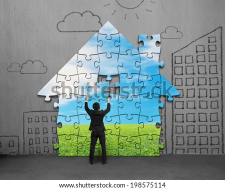 Assembling house shape puzzles on concrete wall #198575114