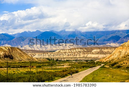 Cloudy sky over a mountain valley. Mountain valley landscape. Hill valley in mountains