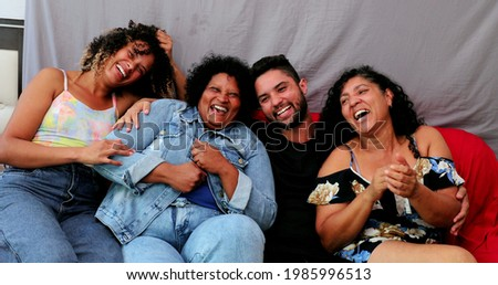 Happy Brazilian family laughing together. Casual hispanic latin people laugh, real life Royalty-Free Stock Photo #1985996513
