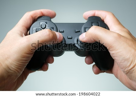Video game console controller in gamer hands #198604022