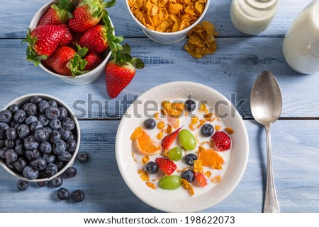 Preparations for breakfast corn flakes and fruits #198622073