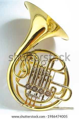 Yellow full double Bb\F French horn brass wind musical instrument on a white background Royalty-Free Stock Photo #1986474005