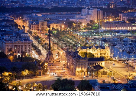 Night in the city of Barcelona in Catalonia, Spain. Columbus Monument and boulevard along Port Vell. #198647810