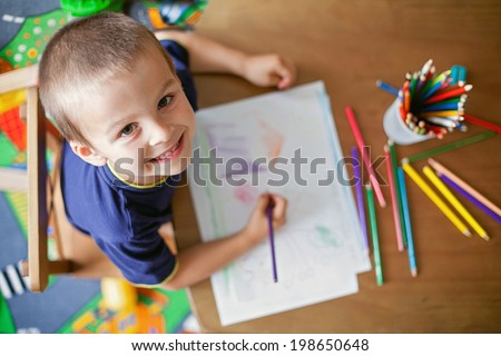 Boy, drawing a picture for fathers day