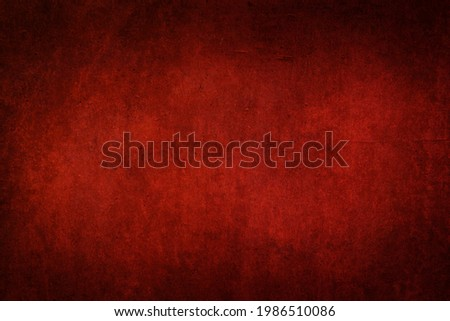 Red dark wall with vignetting and light spots. Minimalistic template for Halloween posters and banners