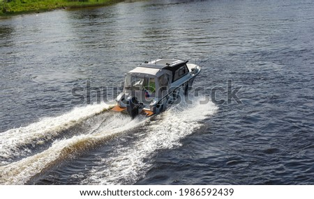 speedboat rides on the lake, speedboat rides on the river, boat trips, boat fishing Royalty-Free Stock Photo #1986592439