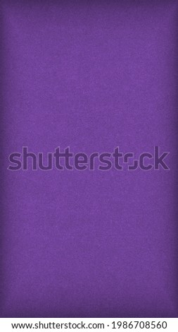 Purple colored paper texture. Bright summer mobile phone wallpaper. Deep violet vertical background with vignetting. Textured surface, fibers and irregularities are visible. Top-down