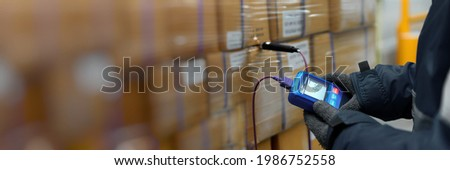 Hand of worker using thermometer to temperature measurement in the goods boxes with ready meals after import in the cold room or warehouse for keep temperature room, Logistics Banner with copy space Royalty-Free Stock Photo #1986752558