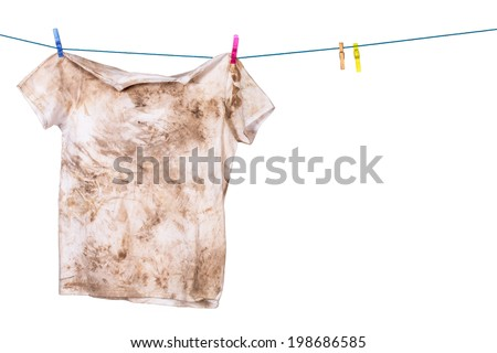 dirty shirt hanging to dry Royalty-Free Stock Photo #198686585