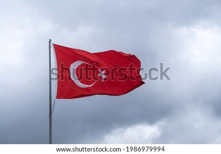 turkish flag waving, cloudy sky, flagpole,  Royalty-Free Stock Photo #1986979994