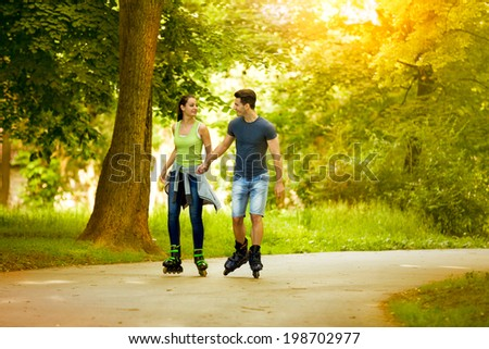 love couple looking at each other and roller skating #198702977