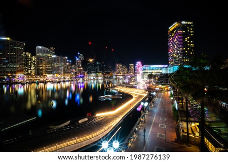 Panoramic night view of Sydney Harbour and City Skyline of Darling Harbour and Barangaroo Australia bright neon lights reflecting off the water Royalty-Free Stock Photo #1987276139