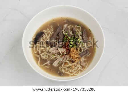 Photo of freshly cooked Filipino dish called Batchoy or noodle soup with pork and beef in chicken stock.