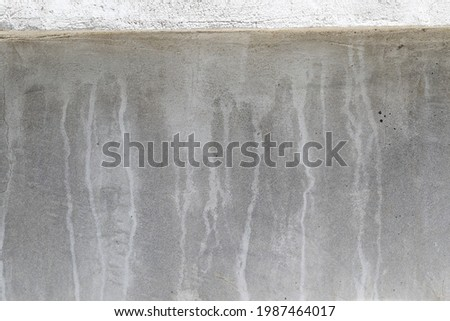 The walls with watermark. White watermark on the concrete wall.