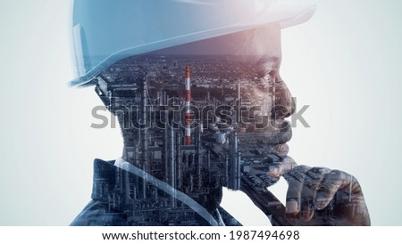 Silhouette of thinking man and modern factory. Double exposure.