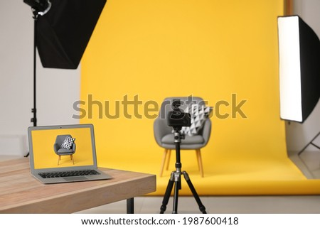 Interior of modern studio during photographing of furniture Royalty-Free Stock Photo #1987600418