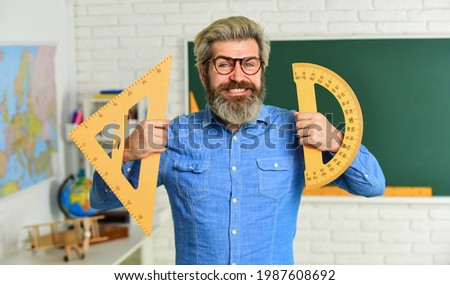 Math subject. Geometry and algebra. Theorem. Talented teacher. Private lesson. Back to school. Study mathematics. Man mentoring school projects. Science concept. Mature bearded teacher in glasses