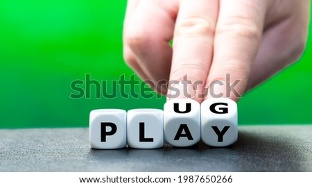 """Dice form the words """"plug"""" and """"play"""". Royalty-Free Stock Photo #1987650266"""