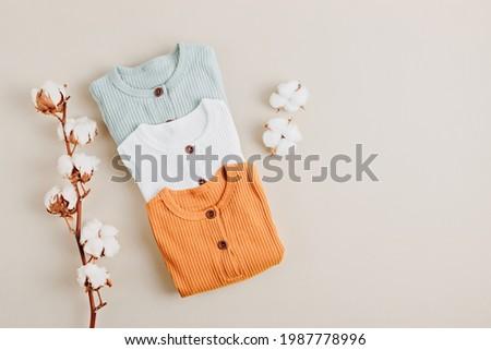 Gender neutral baby garment. Organic cotton clothes, newborn fashion Royalty-Free Stock Photo #1987778996