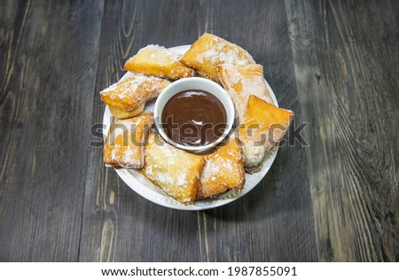 Beignets, French pastries deep fried and coated with baker's sugar.