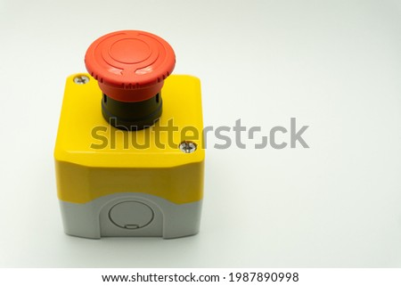 emergency stop button. Big Red emergency button or stop button for manual pressing. STOP button for industrial equipment, emergency stop. Red light. At the factory and industrial facility. Royalty-Free Stock Photo #1987890998