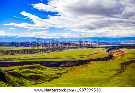 A cleft in a mountain valley. Mountain valley landscape. Green valley in mountains