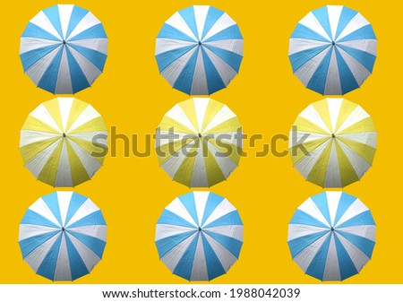 Collection of umbrella set isolated on yellow background, stock photo , summer, business, top view