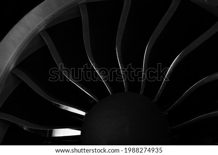 Plane background. Airplane turbine blades close-up. Airplane engine. Turbines blade. Aviation Technologies. Aircraft jet black detail during maintenance. Macro. Royalty-Free Stock Photo #1988274935