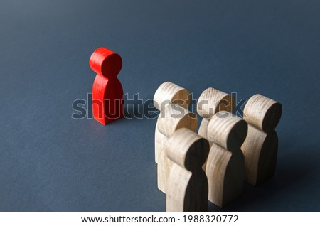 Red man and group of people. Leadership. Recognition of being a leader by team members. Establishing contact. Quantitative superiority. Cooperation against enemy. Dominance and headship, psychology. Royalty-Free Stock Photo #1988320772