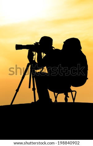 Silhouette of photographer shooting for a sunrise #198840902