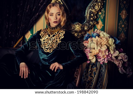 Beautiful fashion model in a rich historical dress. Vintage. Luxury style.  #198842090