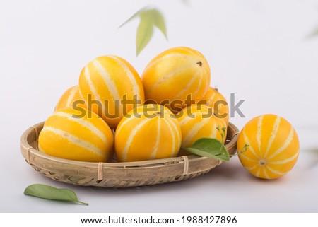 Korean Melon or oriental malon on white background. Royalty-Free Stock Photo #1988427896