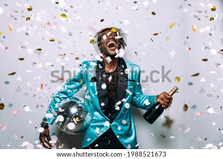 portrait of an hip hop music musician. Cinematic image of a man under confetti drop