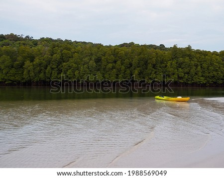 Kayak boat in mangrove forest canal on tropical island. Outdoor recreation kayaking sport. Koh Kood - Thailand.