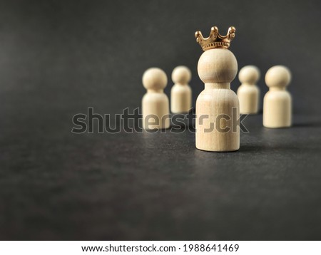 Image of wooden toy with crown background. Leadership concept. Stock photo.