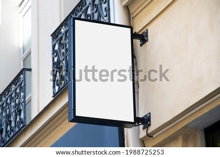 Shop sign Mockup. Rectangular vertical storefront on a wall in street template
