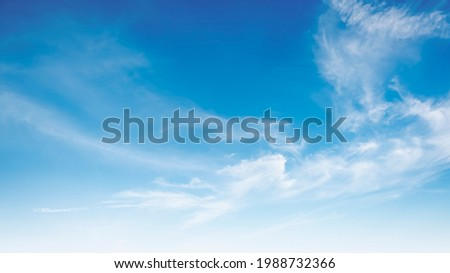 The sky has the light of the sun, the sky is blue, there are small and large clouds alternating and moving slowly, with the sunlight passing, creating a miraculous abstract shape, a hot day. Royalty-Free Stock Photo #1988732366
