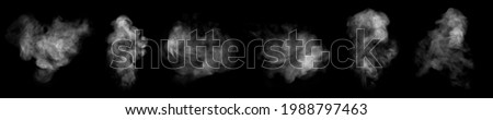 Set. Close-up of steam or abstract white smog rising above. water droplets that can be seen that swirl beautifully from humidifier spray. Isolated on a black background Royalty-Free Stock Photo #1988797463