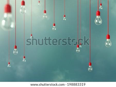 Photo of Hanging light bulbs with depth of field. Modern art